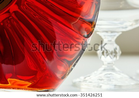 Bottle of cognac and empty glass - stock photo