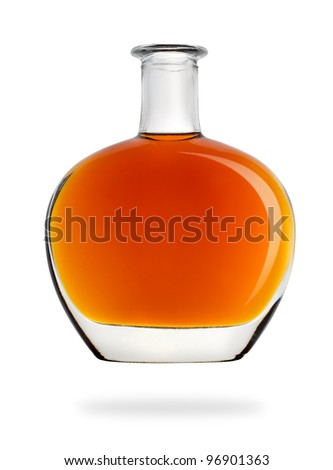 Bottle of cognac isolated - stock photo