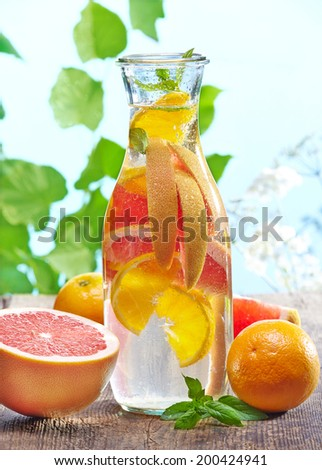bottle of cold nonalcoholic citrus fruit drink - stock photo