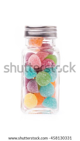 bottle of colorful jellys isolated on white background
