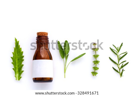 Bottle of essential oil with herb holy basil leaf, rosemary,oregano, sage,basil and mint on white background. - stock photo