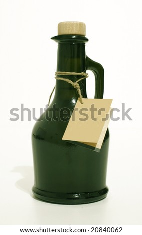 Bottle of extra virgin olive oil in green bottle