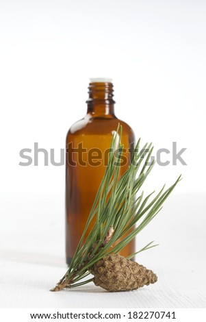 Bottle of fir tree essential oil over white  - stock photo