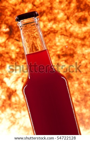 bottle of fresh drink on texture background