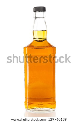 Bottle of Golden Brown Whisky on a background - stock photo