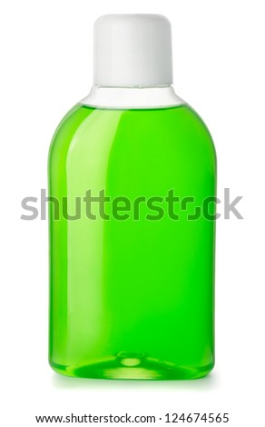 Bottle of green antibacterial mouthwash isolated on white - stock photo