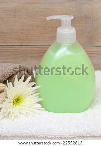 Bottle of hand soap in a bathroom setting - stock photo