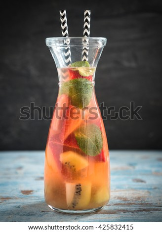 Bottle of homemade juice with fruit slices,selective focus  - stock photo