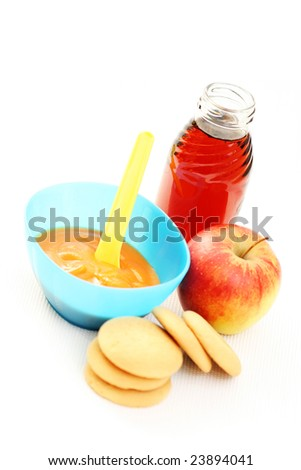 bottle of juice and bowl of carrot - baby food