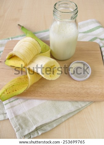 Bottle of kefir with banana - stock photo