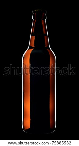 Bottle of lager beer from brown glass, isolated on a black background. - stock photo
