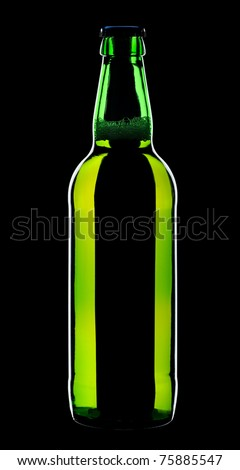 Bottle of lager beer from green glass, isolated on a black background. - stock photo