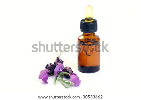 bottle of lavender oil and fresh lavender flowers - beauty treatment