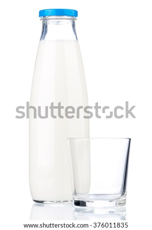 Bottle of milk and empty glass isolated on white background - stock photo
