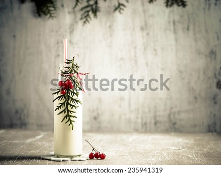 Bottle of milk with  branch of tree and viburnum. Toned photo. Space for text - stock photo