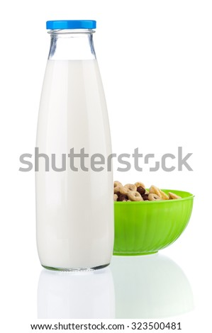 Bottle of milk with tasty cornflakes, isolated on white background  - stock photo