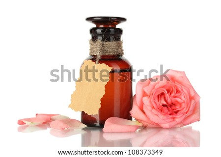 bottle of oil and rose isolated on white - stock photo