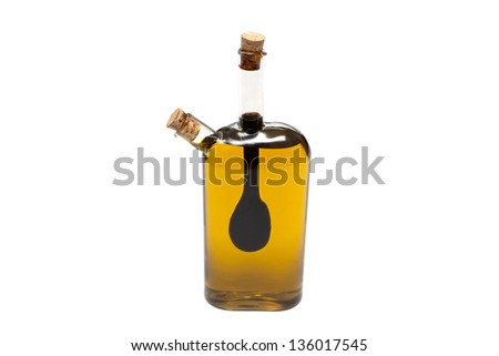Bottle of oil and syrup on a white background