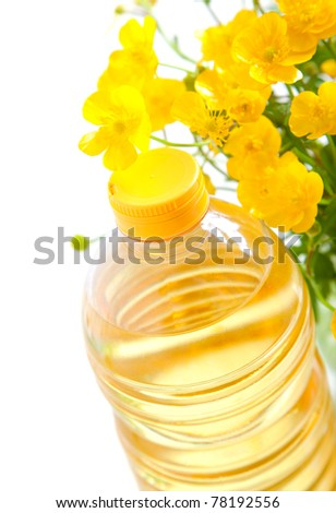 bottle of oil with flower, on a white background