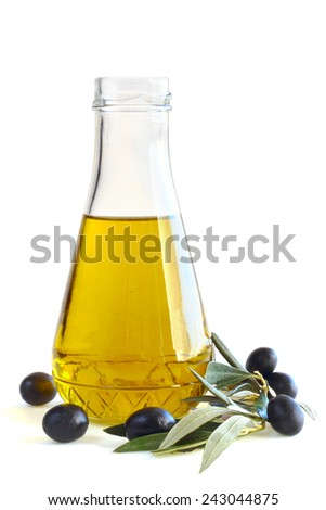 Bottle of olive oil and black olives isolated on white background - stock photo