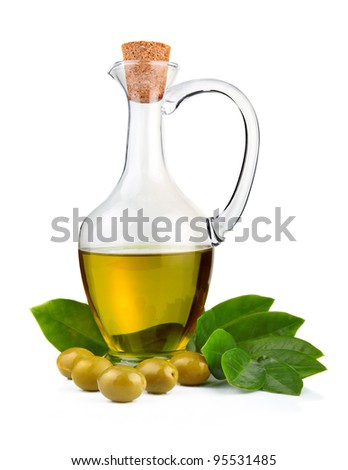 Bottle of olive oil and green leaves isolated on white background