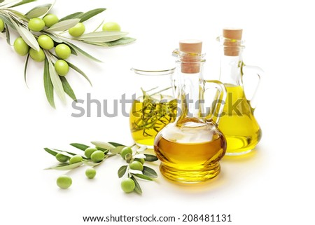 bottle of olive oil and green olives on white background - stock photo