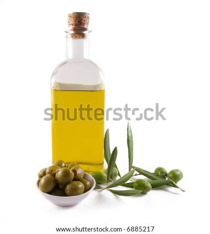 Bottle of olive oil and olives - stock photo