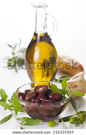 bottle of olive oil with branch olives isolated on white background - stock photo