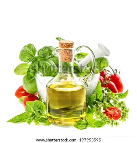 bottle of olive oil with fresh basil leaves and tomatoes isolated on white. italian food ingredients - stock photo