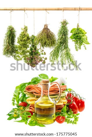 bottle of olive oil with fresh italian pasta, herbs and tomatoes on white. food background with herbs - stock photo