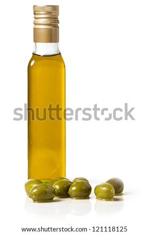 Bottle of olive oil with olives, on white background - stock photo