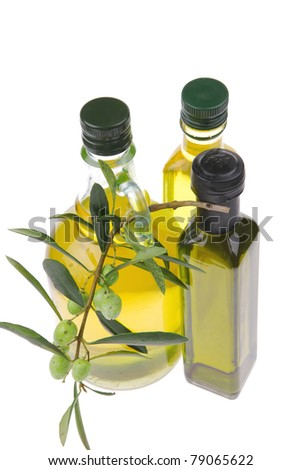 bottle of olive oil with raw olives