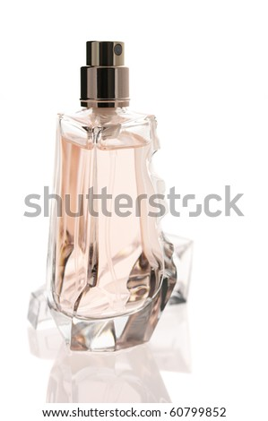 Bottle of opened perfume isolated on white background with reflection.