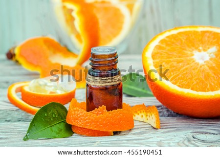 Bottle of orange essential oil for aromatherapy (Extract, tincture, decoction, juice) medicinal properties of orange. - stock photo