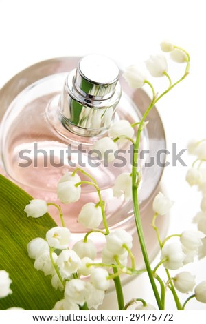 Bottle of perfume and lilies-of-the-valley