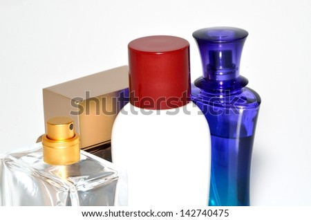 Bottle of perfume close-up on white background - stock photo