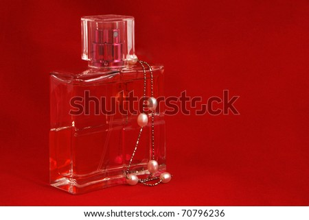 Bottle of perfume on a red background