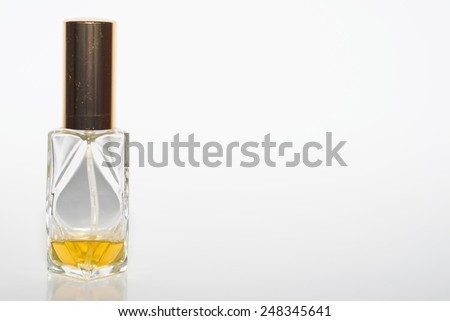 Bottle of perfume on white background - stock photo