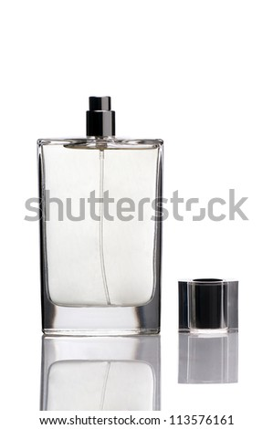 Bottle of perfume on white background with cap - stock photo