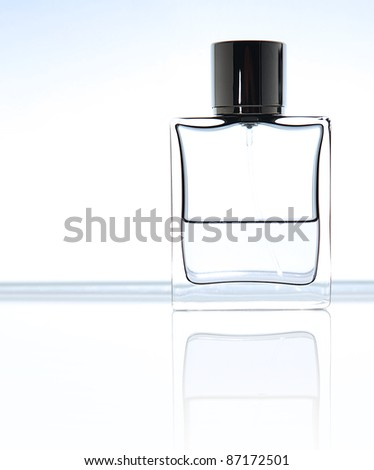 Bottle of perfume, personal accessory, aromatic fragrant odor,  studio shot still life, over light background with copy space