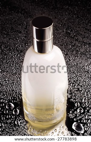 Bottle of perfume with mirror reflection - stock photo