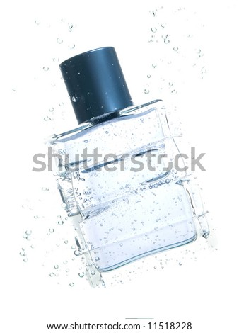 bottle of perfumes in water - stock photo
