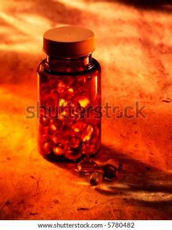 Bottle of pills in warm light - stock photo