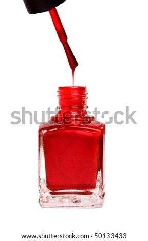 bottle of red nail polish, a brush with a drop