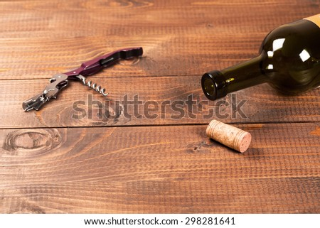 Bottle of red wine and corks. - stock photo