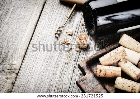 Bottle of red wine and corks. Wine list concept - stock photo