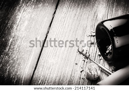 Bottle of red wine and corkscrew. Wine list concept  - stock photo