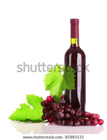 bottle of red wine and grapes isolated on white