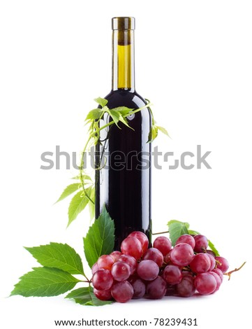 Bottle of red wine with grapes, white background - stock photo