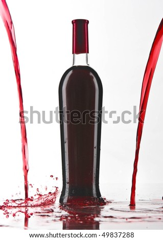 bottle of red wine with pouring wine - stock photo
